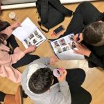 Young people writing in Challenge Wales workbooks