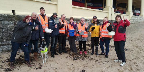 Challenge Wales volunteers on Barry Island beach doing a microplastics survey
