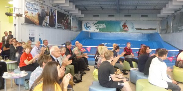 Challenge Wales guests sat at the Cardiff International White Water listening to speakers
